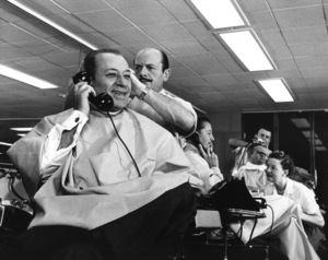 "George Raft and Lawrence Welk getting haircuts prior to the filming of the 1955 television show ""NBC Spectacular"" © 1978 Sid Avery - Image 6054_0002"
