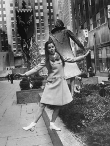 Geraldine Chaplin gaily walks atop a flowerbox in New York