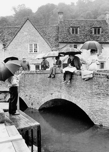 """Director Richard Fleischer forcing the actors to rehearse in the rain during the making of """"Doctor Dolittle""""1967 20th Century Fox © 1978 Bob Willoughby - Image 6622_0005"""