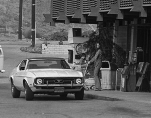 Ali MacGraw and son Joshua getting into her Ford Mustangcirca 1970s© 1978 Gary Lewis - Image 6628_0223