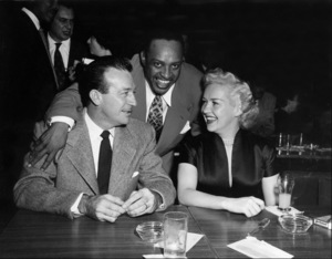 Lionel Hampton (center) with Harry James and Betty Grable, circa 1950. © 1978 Bob Willoughby / MPTV - Image 6637_112