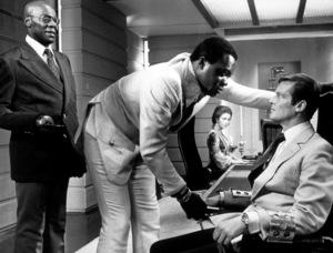 """Live and Let Die,""Julius  W. Harris, Yaphet Kotto, Roger Moore1973 MGM / MPTV - Image 6773_0006"