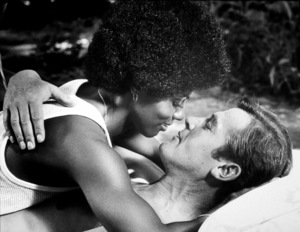 """""""Live and Let Die,""""Gloria Hendry, Roger Moore © 1973 MGM / MPTV - Image 6773_0011"""