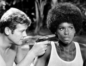 """""""Live and Let Die,""""Roger Moore, Gloria Hendry © 1973 MGM / MPTV - Image 6773_0012"""
