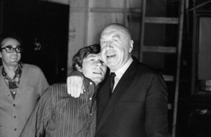 "Director Otto Preminger visiting director Roman Polanski on the set of ""Rosemary"