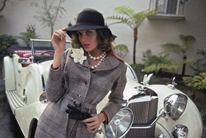 Rene Russo in a Pendleton clothing advertisement with an Alvis car1974 © 1978 Sid Avery - Image 7248_0011