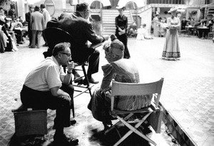 """Clifford Odets visits with Shirley MacLaine, sitting just behind director Walter Lang on the 20th Century Fox set of """"Can-Can""""1959 © 1978 Bob Willoughby - Image 7287_0020"""