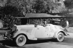 728-670 JOAN CRAWFORD IN HER 1934 FORD ROADSTERCIRCA 1934*M.W.*  - Image 728_670
