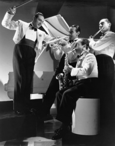 Guy Lombardo leads his brothers Carmen, Lebert and Victor in Paramount