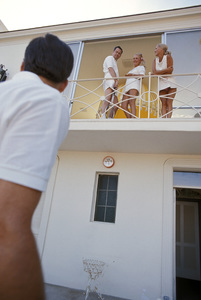 William Barron Hilton with wife Marilyn Hawley and friend on balcony of their home1970 © 1978 Gunther - Image 7485_0022