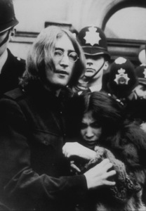 John Lennon and Yoko Ono as they leave a courthearing on charges of marijuana possession,October 19, 1968MPTV - Image 7648_0009