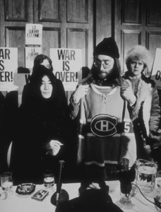 John Lennon and Yoko Ono receive a giftin Montreal after news conferenceDecember 1969MPTV - Image 7648_0010