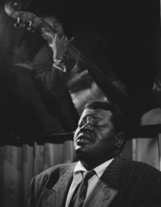 Oscar Peterson at the piano with bassist Ray Brown in the reflection1966 © 1978 Jason Hailey - Image 7674_0001