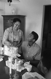 Cassius Clay being served breakfast by his mother Odessa at their Louisville, Kentucky home 1963 © 1978 Gunther - Image 7683_0448