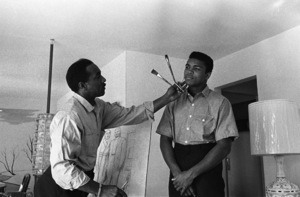 Cassius Clay holds pose while father sketches him in their Louisville, Kentucky home (Cassius Sr. is a commercial artist)1963© 1978 Gunther - Image 7683_0458