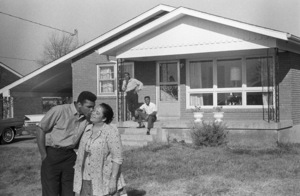 Cassius Clay kisses his mother, Odessa, in front of their Louisville, Kentucky home as his father, Cassius Sr., and brother, Rudy, look on1963© 1978 Gunther - Image 7683_0459