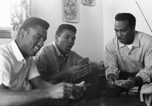 Cassius Clay playing cards with his father, Cassius Sr., and brother, Rudy, at their Louisville, Kentucky home1963© 1978 Gunther - Image 7683_0460