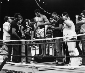 """Muhammad Ali weighs in for the """"Thrilla in Manila,"""" a fight against friend-turned-rival Joe Frazier1975© 1978 Gunther - Image 7683_0490"""