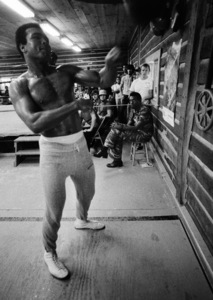 Black Power activist Stokely Carmichael watches Muhammad Ali from a stool in the corner1974© 1978 Peter Angelo Simon - Image 7683_0531