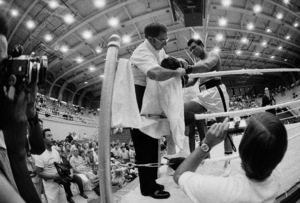 Angelo Dundee fixing Muhammad Ali