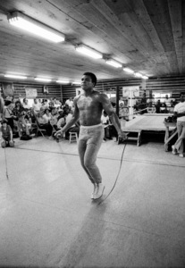 Lightweight world boxing champion Ike Williams (immediately to left of Muhammad Ali on white stool); boxer Bobby McQuillam (to right of Ali leaning against table)1974© 1978 Peter Angelo Simon - Image 7683_0609