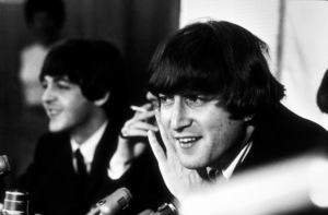 The Beatles in a press conference in Los Angeles, CA., (John Lennon in the foreground,listeningto a question), 1966 © 1978 by Bud Gray / MPTV - Image 7685_0014