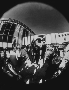 The Beatles, arriving in Los Angeles (shot through a fish lens), 1964 © 1978 Bud Gray / MPTV - Image 7685_0019