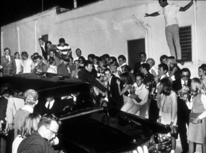 The Beatles, being driven in to Los Angeles, CAsurrounded by fans and the press.1966 © 1978 Bud Gray / MPTV - Image 7685_0024