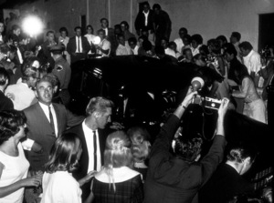 The Beatles, being driven in Los Angeles, CAas Fans and press flock to the scene,1964 © 1978 Bud Gray / MPTV - Image 7685_0025