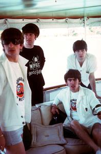 The Beatles, (Ringo Starr, John Lennon, George Harrison, Paul McCartney) on board ship.1964 © 1978 Gunther / MPTV  - Image 7685_0037