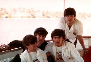 The Beatles, (Ringo Starr, John Lennon, George Harrison, Paul McCartney) on board a boat.1964 © 1978 Gunther / MPTV - Image 7685_0038