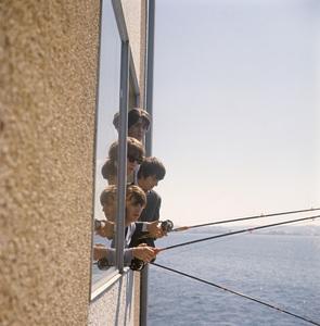 The Beatles (Paul McCartney, John Lennon, George Harrison, Ringo Starr) fish outside of their Edgewater Hotel room in Seattle08-21-1964© 1978 Gunther - Image 7685_0055