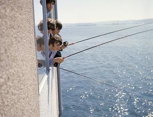 The Beatles (Paul McCartney, John Lennon, George Harrison, Ringo Starr) fishing outside a window1964 © 1978 Gunther - Image 7685_0104a