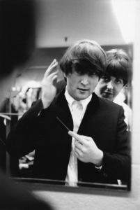 The BeatlesJohn Lennon and Paul McCartney backstage fixing John