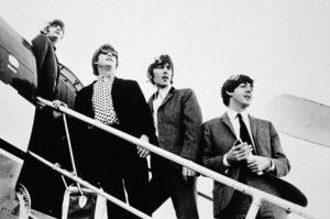 The Beatles (Ringo Starr, John Lennon, George Harrison, and Paul McCartney) boarding a plane circa 1965 © 1978 Gunther - Image 7685_0118