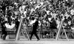 Beatles Fans enjoying the concert atShea Stadium, August 15, 1965,Fans being dragged out from the field. © 1978 George E. Joseph - Image 7685_0168