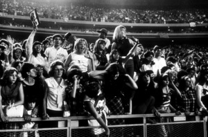 Beatles Fans enjoying concert atShea Stadium, August 15, 1965 © 1978 Gunther / MPTV  - Image 7685_0170