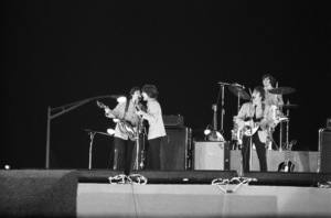 The Beatles performing at Shea Stadium (Paul McCartney, George Harrison, John Lennon, Ringo Starr) August 15, 1965 © 1978 George E. Joseph - Image 7685_0187