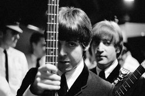 Paul McCartney and John Lennon of the Beatles getting ready to go on stage in Montreal1964© 1978 Gunther - Image 7685_0254