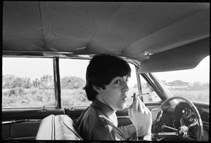 Paul McCartney of the Beatles driving a Cadillac in Key West on a day of rest09-09-1964 © 1978 Gunther - Image 7685_0256