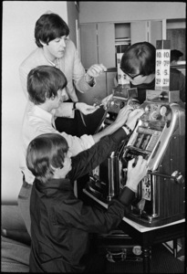 Paul McCartney, John Lennon, George Harrison and Ringo Starr of the Beatles playing a slot machine at the Sahara Hotel in Las Vegas08-20-1964© 1978 Gunther - Image 7685_0281