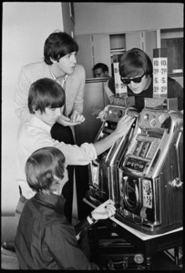 Paul McCartney, John Lennon, George Harrison and Ringo Starr of the Beatles playing a slot machine at the Sahara Hotel in Las Vegas08-20-1964© 1978 Gunther - Image 7685_0282