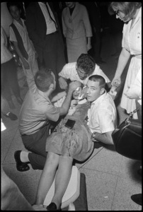 An injured girl who fell through a glass window where the Beatles were staying at the Cabana Motor Hotel in Dallas, Texas09-18-1964© 1978 Gunther - Image 7685_0291