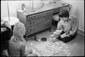 George Harrison playing Monopoly with Jackie DeShannon at the Lafayette Motor Inn in Atlantic City, New Jersey08-30-1964© 1978 Gunther - Image 7685_0294