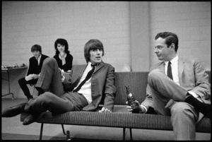 George Harrison of the Beatles with manager Brian Epstein1964© 1978 Gunther - Image 7685_0299