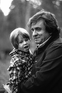 Johnny Cash at home in Hendersonville, Tennessee with his grandson, Josh Cash Gatlin1980© 1980 Ron Sherman - Image 7857_0050