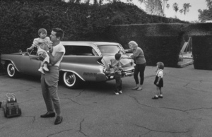 Jackie Cooper, wife Barbara and their children at their home in Brentwood California with his Pontiac Wagon 1961 © 1978 Sid Avery - Image 78_18
