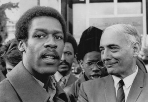 Black Panther chief of staff David Hilliard speaks to newsmen while attorney Charles Garry looks on / Berkeley, CA / 1969 - Image 7950_0002