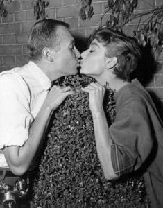 """Photographer Mark Shaw kisses Audrey Hepburn on the set of """"Sabrina""""1953 Paramount© 2000 Mark Shaw - Image 8124_0076"""