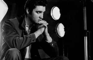 Elvis Presley sitting in front of gallery lights, 1956. © 1978 Bill AveryMPTV - Image 818_452
